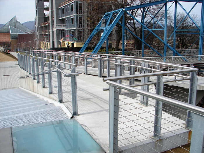 Iron Posts with Stainless Steel Cable used as a Ramp Railing.